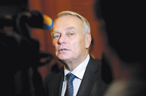 French Prime minister Jean-Marc Ayrault answers journalists' questions after casting his ballot...